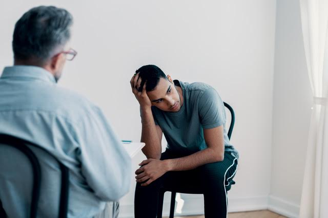 counselor evaluating rehab client