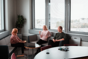 Three women in group therapy activities